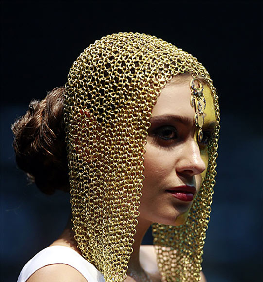 A model displays gold jewellery.