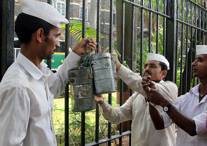 Mumbai's 'Dabbawalas' hike charges to fight rising inflation