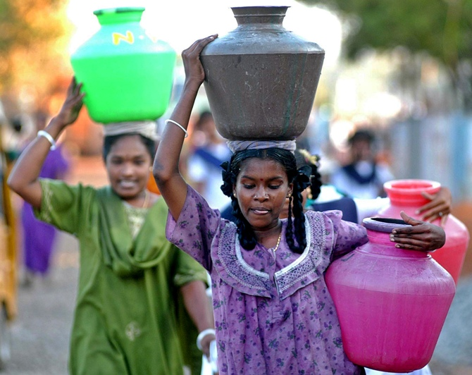 This file photograph shows women tsunami survivors carrying pots of drinking water in tsunami-hit Nagapattinam, Tamil Nadu.