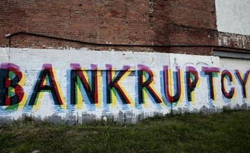 The word 'Bankruptcy' is seen painted on the side of a vacant building by street artists as a statement on the financial affairs of the city on Grand River Avenue in Detroit, Michigan July 26, 2013.