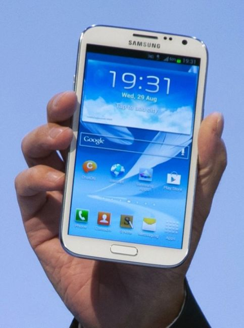 A man presents the new Samsung Galaxy device.