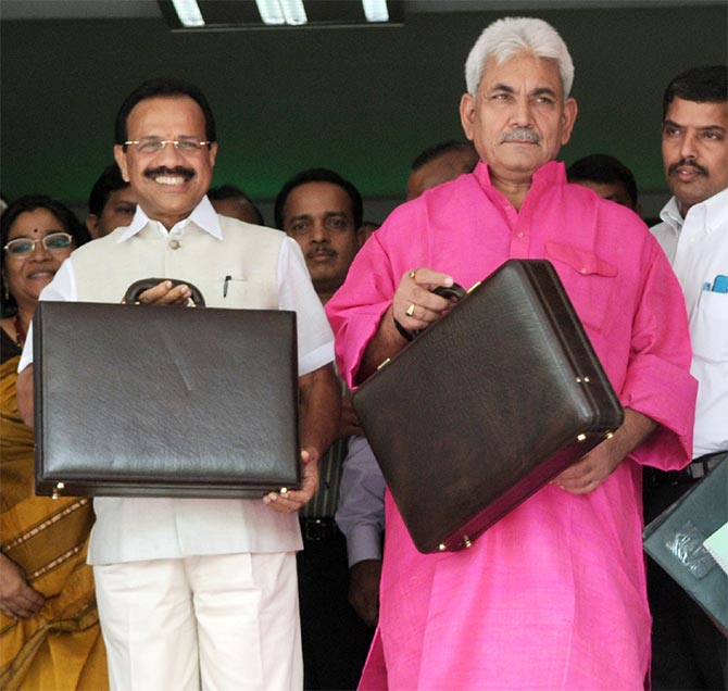 Railway Minister Sadanand Gowda and Minister of State for RailwaysManoj Sinha.