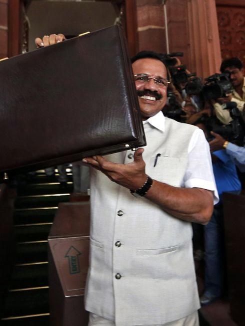 India's Railway Minister Sadananda Gowda arrives to present the railway budget for the 2014/15 fiscal year.