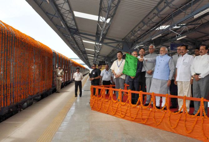 prime Minister Narendra Modi flags off a new train.