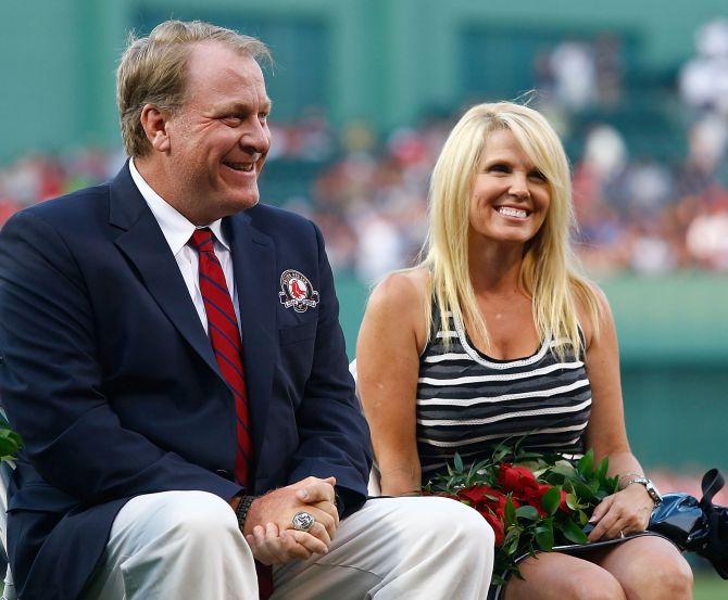 Former Boston Red Sox pitcher Curt Schilling #38 sits with his wife, Shonda Schilling.