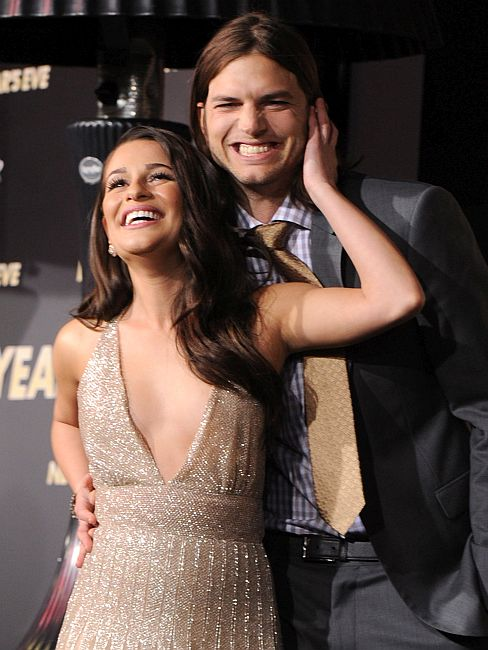 Actress Lea Michele (L) and actor Ashton Kutcher arrive at the premiere of Warner Bros. Pictures' 'New Year's Eve'.
