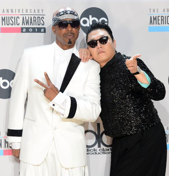 Musicians MC Hammer and Psy.
