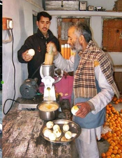 A family uses electricity for making juice for sale.