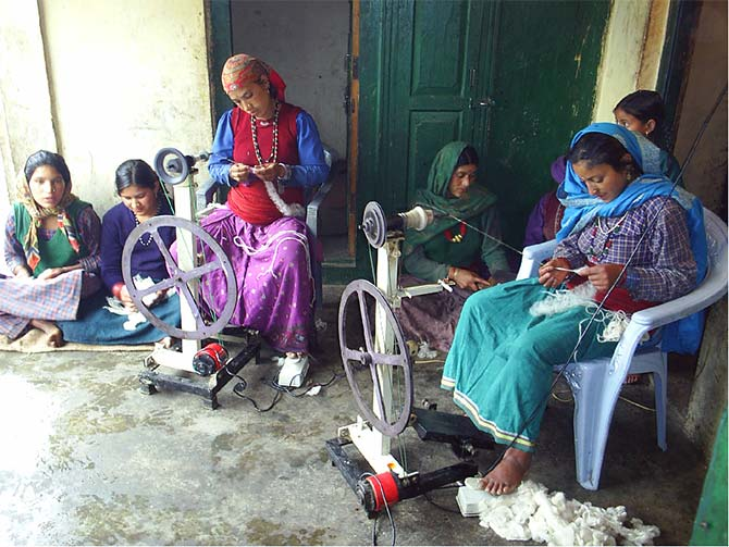 In village Genwali,  women use carded wool to spin yarn using their own hydropower.