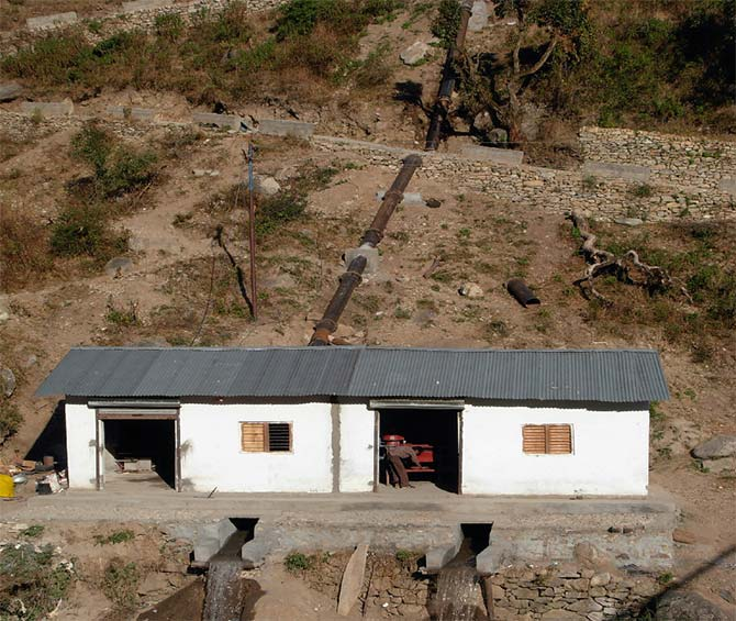 At Agunda village in Uttarakhand, a village power house supported by UNDP was designed and set up by Jansamath NGO in the year 2008 for multipurpose benefits: electricity and mechanical power or shaft power, using two turbines for lighting, heating and cooking, milling, oil expelling, wool processing, welding etc.