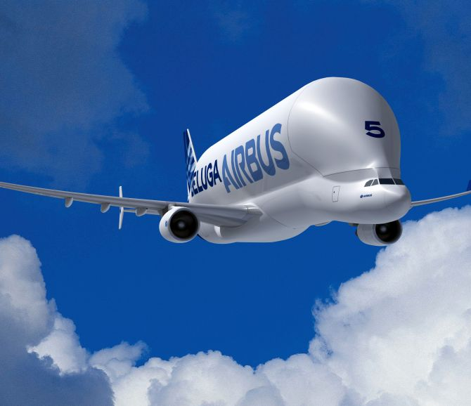 Airbus Beluga transport plane flies in the evening sky after taking off from the Airbus facility in Finkenwerder near Hamburg in Germany.