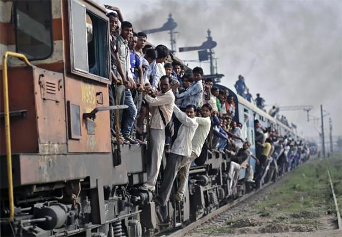 Passengers travel on an overcrowded train at Loni town in Uttar Pradesh.