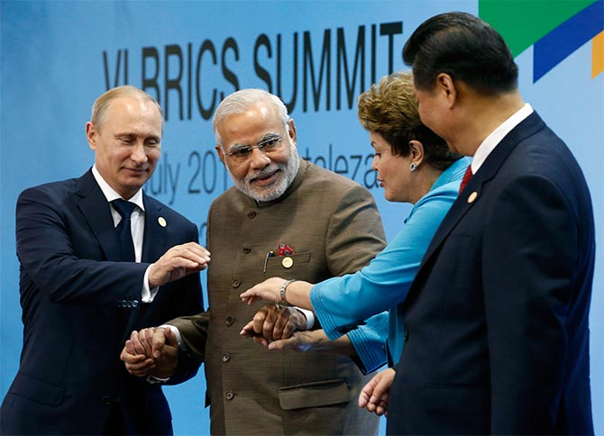 (L-R) Russia's President Vladimir Putin, India's Prime Minister Narendra Modi, Brazil's President Dilma Rousseff and China's President Xi Jinping pose for a group picture during the VI BRICS Summit in Fortaleza.