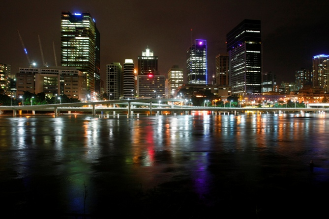 The Brisbane River is seen flowing past the skyline of central Brisbane.
