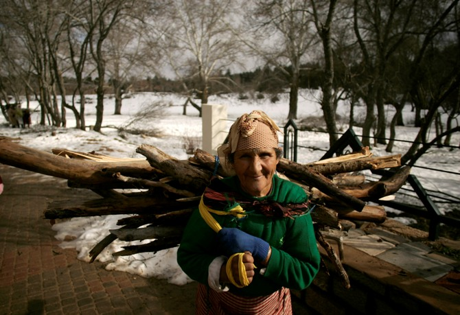 A woman carries firewood through a forest near Ifrane in the Middle Atlas region of Morocco.
