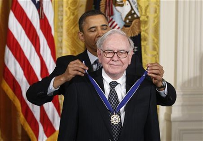 President Obama awards the Medal of Freedom to recipient Warren Buffett.
