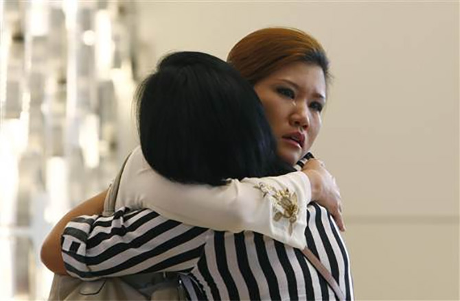 Relatives of a passenger onboard the Malaysia Airlines flight MH370 that disappeared in March.