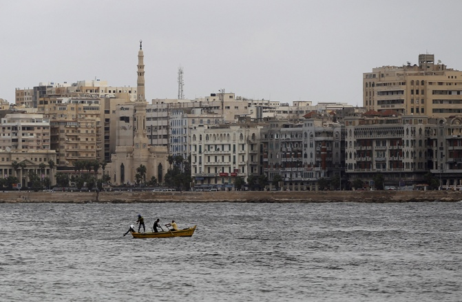 Men fish during the last day of Eid al-Adha in the Mediterranean city of Alexandria, 230 km (143 miles) north of Cairo.