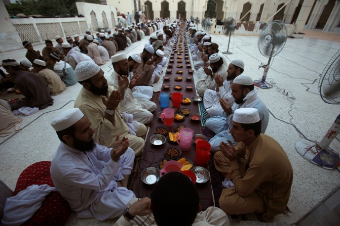 Men pray before breaking their fast on the first day of Ramadan, the holiest month in the Islamic calendar, at a mosque in Peshawar.