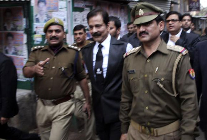 File photo of Subrata Roy being escorted by police to a court in Lucknow on February 28, 2014.