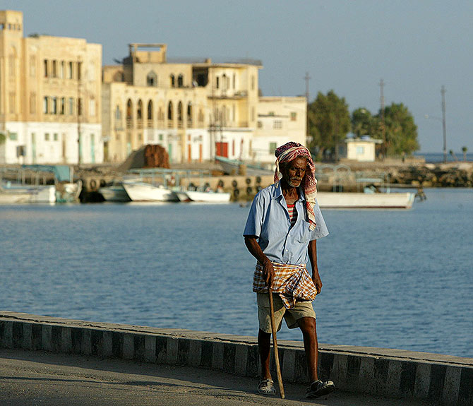 An Eritrean man walks alongside the Red Sea port of Massawa.