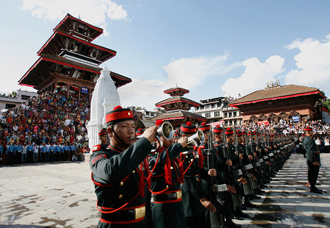 People watch as the guard of honour for Nepal's President Ram Baran Yadav (not pictured) stands at attention during the Indrajatra festival in Kathmandu.
