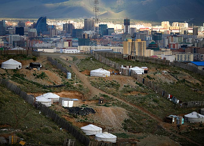 Gers, traditional Mongolian tents, are seen on a hill in an area known as a ger district in Ulan Bator.