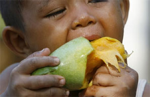 A child eats a mango
