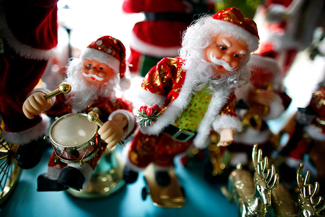 Plastic Santa Claus toys are seen at Christmas shop.
