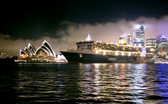 The Queen Mary 2 sets sail past the Sydney Opera House, February 19, 2014. Entering service in 2004, the flagship of the Cunard Line is celebrating its 10th anniversary with a three-week cruise that will circumnavigate Australia.