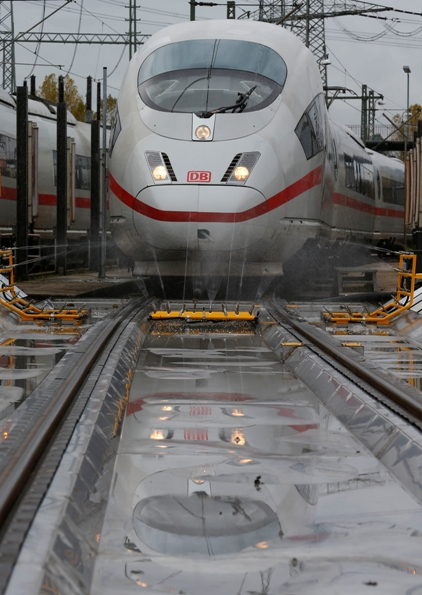 An ICE high speed train of German railway Deutsche Bahn AG approaches the first station of an anti-icing unit at their depot in Frankfurt.