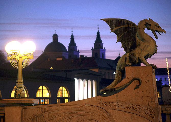 Statue of a dragon is seen on the dragon bridge over river Ljubljanica.