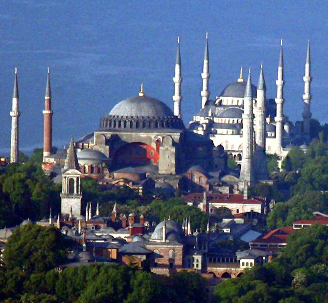The sixth century Byzantinian monument of St. Sofia (Ayasofya) and the 16th century Ottoman era Blue Mosque are seen behind the Topkapi Palace.