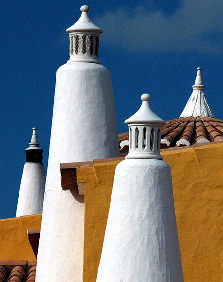 Traditional chimnies of rural houses in the Portuguese Southern province of Algarve.