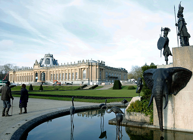 A modern sculpture by Belgian artist Tom Frantzen shows former Belgian King Leopold II surrounded by animals and African warriors in the park of the Royal Museum for Central Africa in Tervuren.