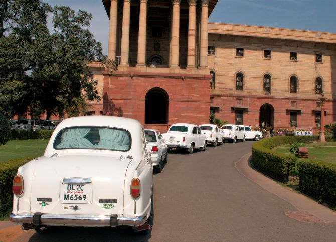 Official Hindustan Ambassador cars waiting in line outside North Block.