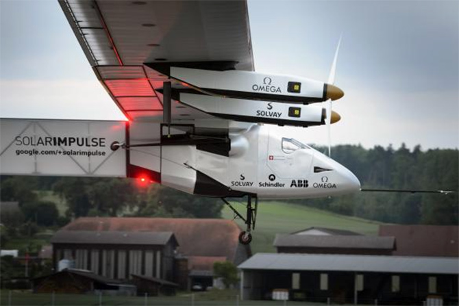solar-powered Solar Impulse 2 experimental aircraft takes off during its maiden flight at its base in Payerne.