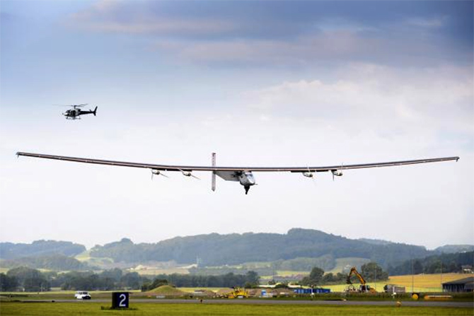 solar-powered Solar Impulse 2 experimental aircraft lands during its maiden flight in Payerne.