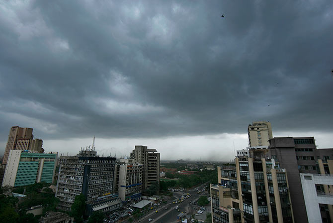 Heavy monsoon clouds drift over New Delhi.