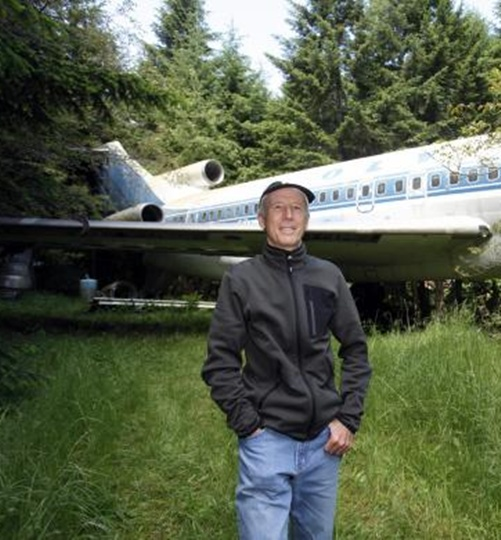 Bruce Campbell stands near his Boeing 727 home.