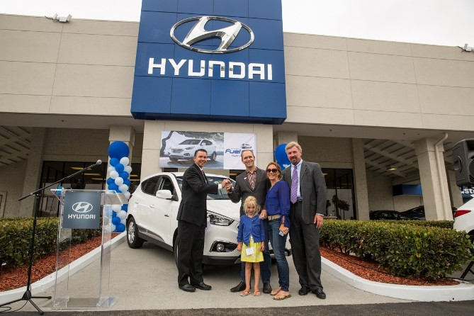 Tustin Hyundai celebrates the first Hyundai Tucson Fuel Cell customer, Timothy Bush, with a key hand-off ceremony at the dealership.