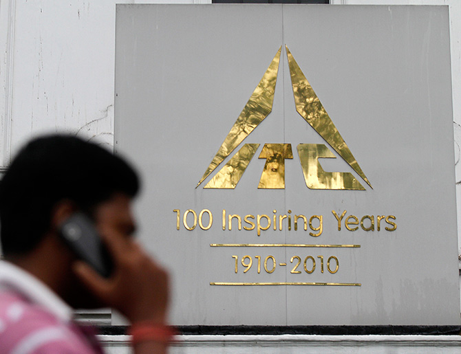 A man talks on his mobile phone as he walks past an ITC office.
