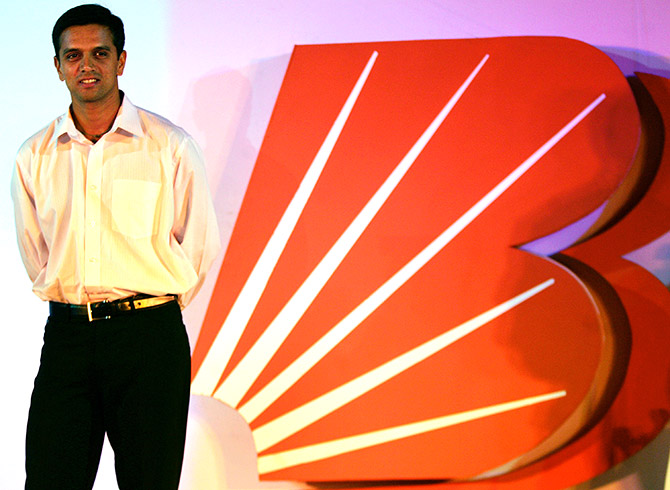 Indian cricket player Rahul Dravid poses for photographers during function to mark rebranding of state-run Bank of Baroda in Bombay.
