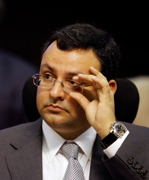 Tata Group chairman Cyrus Mistry adjusts his glasses as he attends the 'Vibrant Gujarat Summit' at Gandhinagar in Gujarat.
