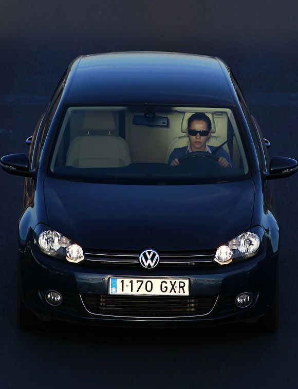A woman driving a car.