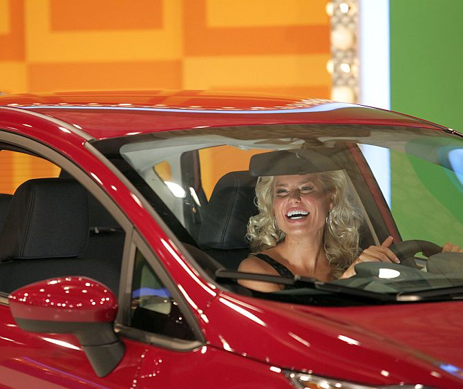 Model Rachel Reynolds drive a car.