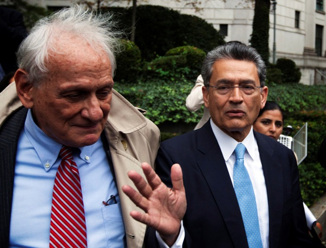 Former Goldman Sachs Group Inc board member Rajat Gupta (R) departs Manhattan Federal Court with his lawyer, Gary Naftalis (L) after being sentenced in New York, October 24, 2012.