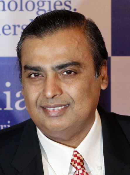 Mukesh Ambani, chairman of Reliance Industries Limited, poses for photographers before addressing the annual shareholders meeting.