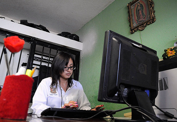 Marisol Valles Garcia sits at her desk at the police station in Praxedis G.Guerrero.