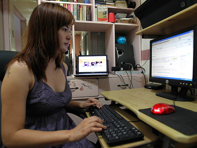 Sheila Ortencio, an online contractor, works on a compute.